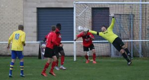 Ivan Willis makes a diving save against Salts FC